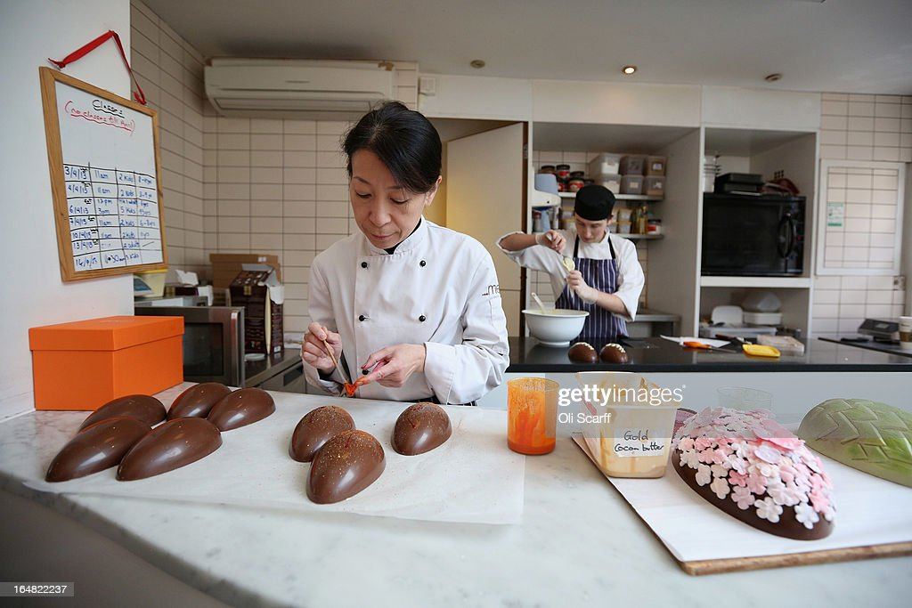 Head chocolatier Chika Watanabe (L) and chocolatier Stephen Glenister create handmade Easter eggs in the 'Melt' chocolate shop in Notting Hill on March 28, 2013 in London, England. Easter represents the busiest time of year for the luxury chocolate retailer 'Melt' who, in addition to their regular customised Easter eggs, also make a range of large themed eggs with a limited edition of 5.