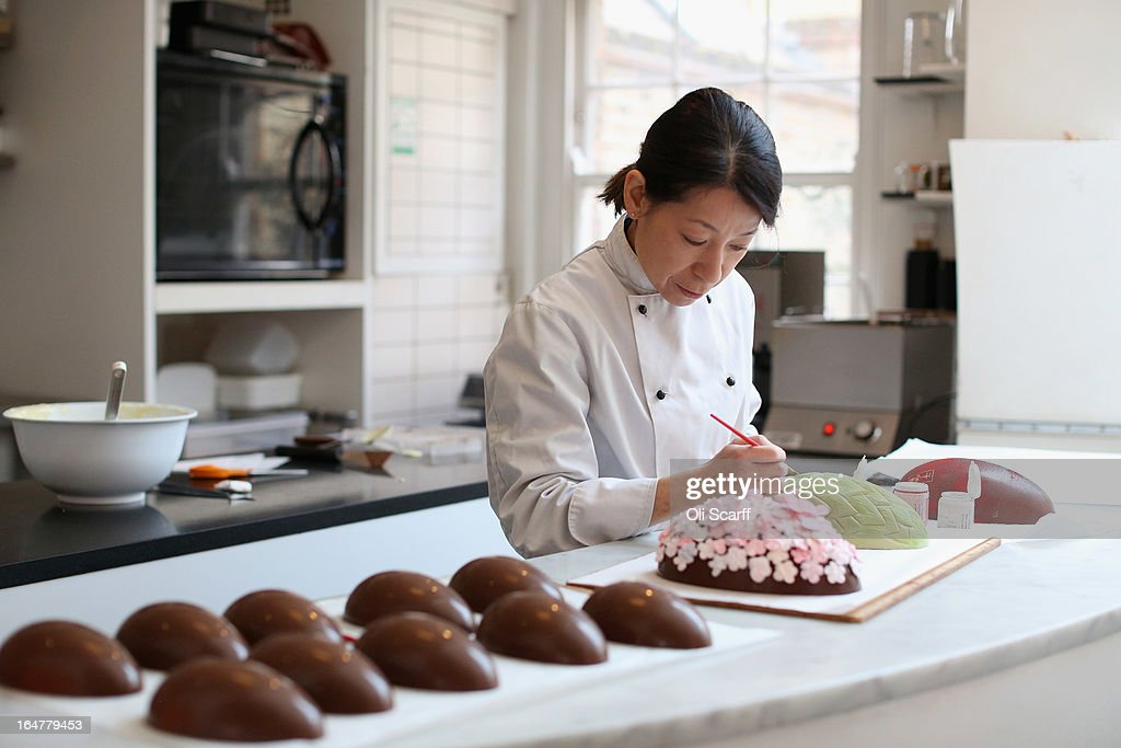 Head chocolatier Chika Watanabe creates handmade Easter eggs in the 'Melt' chocolate shop in Notting Hill on March 28, 2013 in London, England. Easter represents the busiest time of year for the luxury chocolate retailer 'Melt' who, in addition to their regular customised Easter eggs, also make a range of large themed eggs with a limited edition of 5.