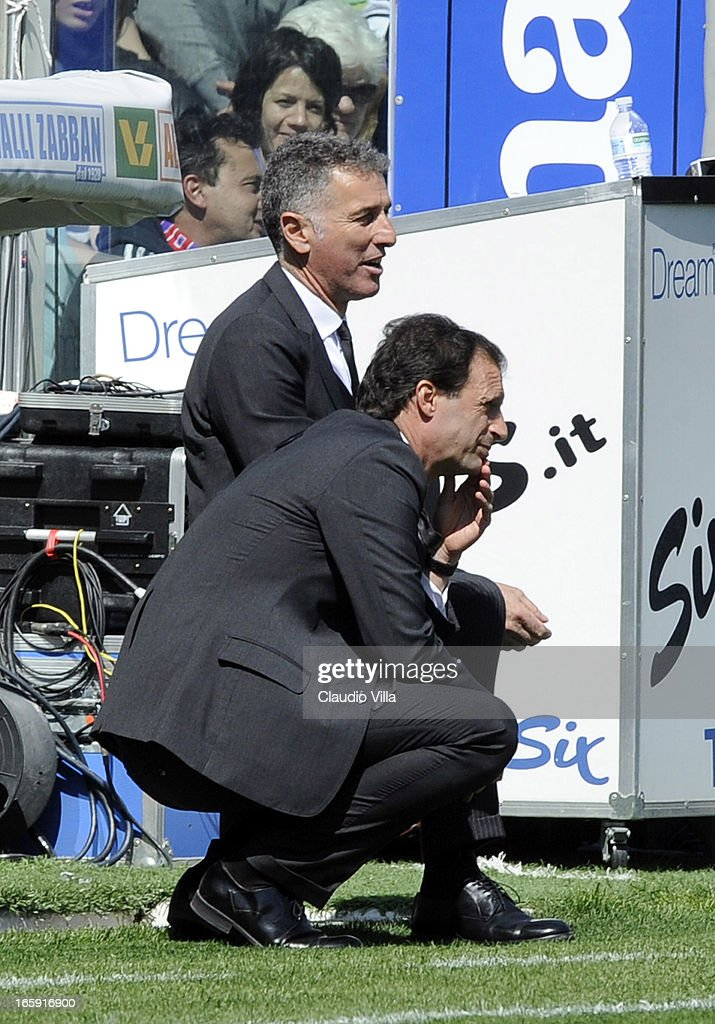 Head coach AC Milan Massimiliano Allegri (R) and assistant coach Mauro Tassotti dejected during the Serie A match between ACF Fiorentina and AC Milan at Stadio Artemio Franchi on April 7, 2013 in Florence, Italy.