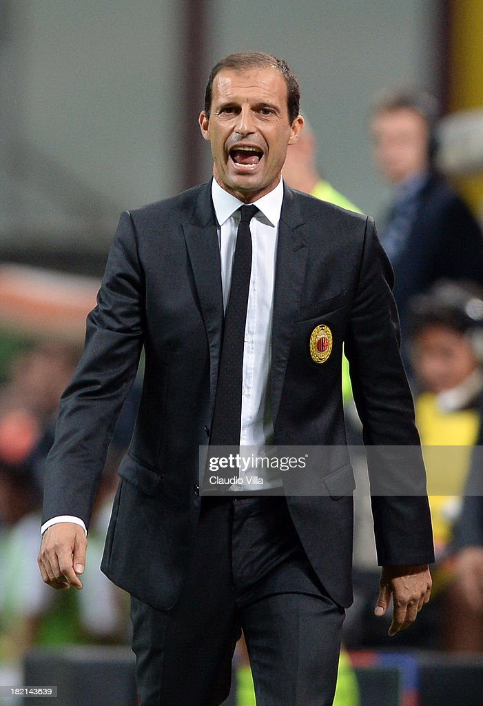 Head coach AC Milan <a gi-track='captionPersonalityLinkClicked' href=/galleries/search?phrase=Massimiliano+Allegri&family=editorial&specificpeople=3470667 ng-click='$event.stopPropagation()'>Massimiliano Allegri</a> reacts during the Serie A match between AC Milan and UC Sampdoria at Stadio Giuseppe Meazza on September 28, 2013 in Milan, Italy.
