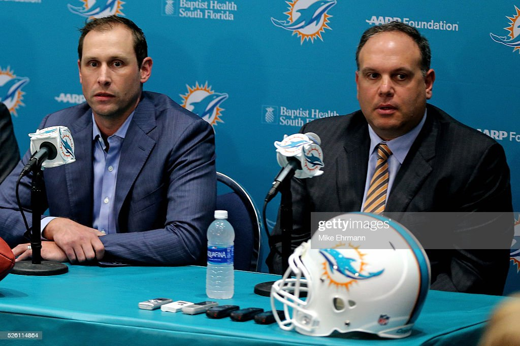 Head coach <a gi-track='captionPersonalityLinkClicked' href=/galleries/search?phrase=Adam+Gase&family=editorial&specificpeople=4402077 ng-click='$event.stopPropagation()'>Adam Gase</a> and Executive Vice President, Football Operations<a gi-track='captionPersonalityLinkClicked' href=/galleries/search?phrase=Mike+Tannenbaum&family=editorial&specificpeople=623248 ng-click='$event.stopPropagation()'>Mike Tannenbaum</a> of the Miami Dolphins talks to members of the press concerning first round draft pick Laremy Tunsil at their training faciility on April 29, 2016 in Davie, Florida.