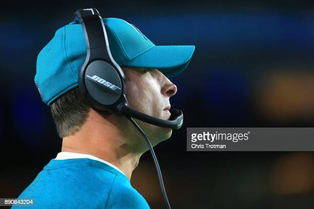 Head coach Adam Gase looking on during the game against the New England Patriots at Hard Rock Stadium on December 11 2017 in Miami Gardens Florida