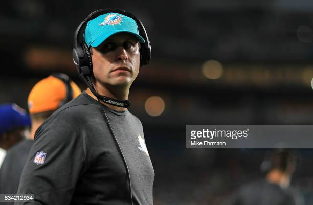 Head coach Adam Gase of the Miami Dolphins looks on during a preseason game against the Baltimore Ravens at Hard Rock Stadium on August 17 2017 in...