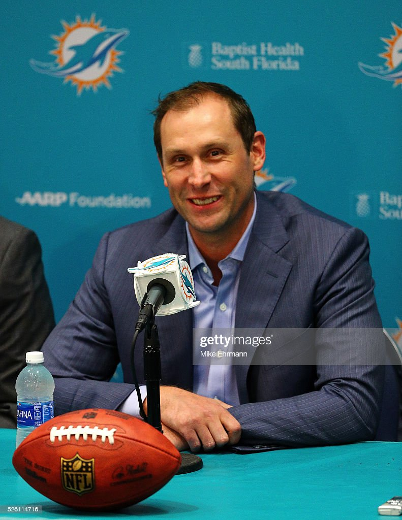 Head coach <a gi-track='captionPersonalityLinkClicked' href=/galleries/search?phrase=Adam+Gase&family=editorial&specificpeople=4402077 ng-click='$event.stopPropagation()'>Adam Gase</a> of the Miami Dolphins talks to members of the press concerning first round draft pick Laremy Tunsil at their training faciility on April 29, 2016 in Davie, Florida.
