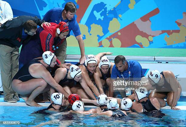 Head Coach Adam Krikorian of the United States huddles with his team prior to the start of the Women's gold medal match between the United States and...