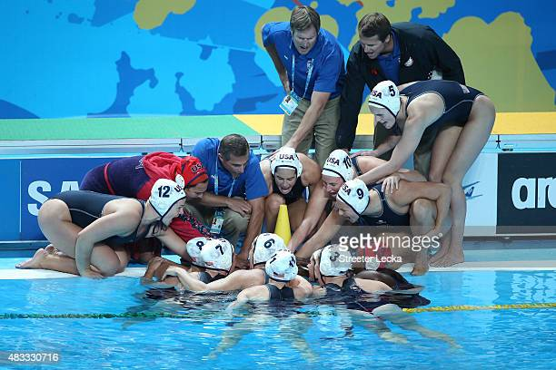 Head Coach Adam Krikorian of the United States huddles with his team during the Women's gold medal match between the United States and the...
