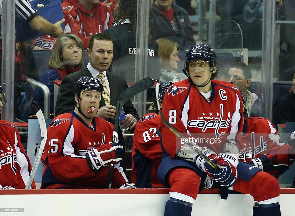 Head coach Adam Oates, Jason Chimera #25 and Alex Ovechkin #8 of the Washington Capitals prepare for play to resume against the New Jersey Devils at the Verizon Center on February 23, 2013 in Washington, DC.