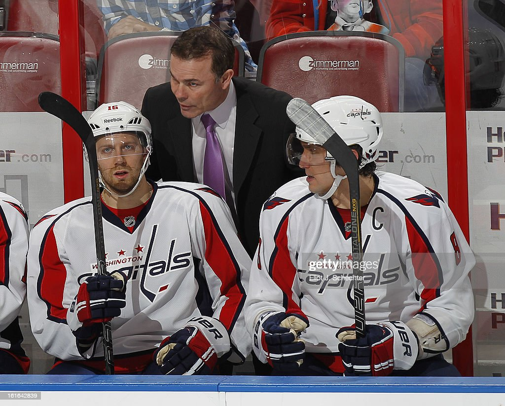 Head Coach Adam Oates of the Washington Capitals chats with Eric Fehr #16 and Alex Ovechkin #8 during a break in the action against the Florida Panthers at the BB&T Center on February 12, 2013 in Sunrise, Florida.