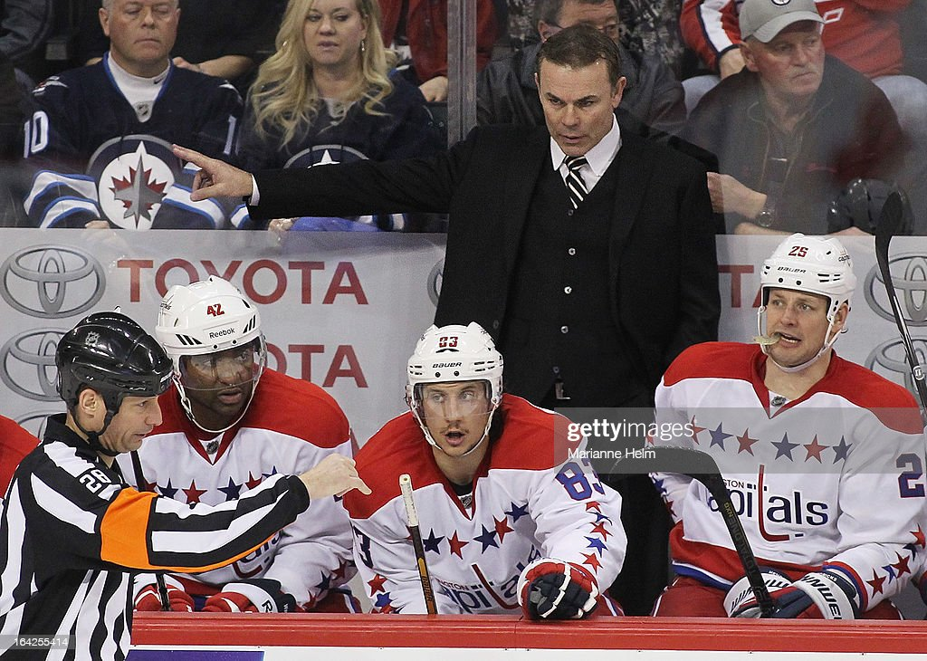 Head coach <a gi-track='captionPersonalityLinkClicked' href=/galleries/search?phrase=Adam+Oates&family=editorial&specificpeople=209315 ng-click='$event.stopPropagation()'>Adam Oates</a> of the Washington Capitals gestures from the bench as players Joel Ward #42, Jay Beagle #83, and <a gi-track='captionPersonalityLinkClicked' href=/galleries/search?phrase=Jason+Chimera&family=editorial&specificpeople=211264 ng-click='$event.stopPropagation()'>Jason Chimera</a> #25 look on during third-period action against the Winnipeg Jets on March 21, 2013 at the MTS Centre in Winnipeg, Manitoba, Canada.
