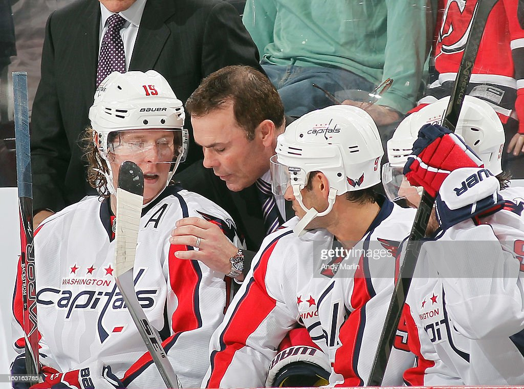 Head coach Adam Oates of the Washington Capitals gives instructions against the New Jersey Devils during the game at the Prudential Center on January 25, 2013 in Newark, New Jersey.