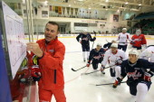 Head Coach Adam Oates of the Washington Capitals goes over a drill with his team at Yardman Arena during Kraft Hockeyville Day 2 on September 14 2013...