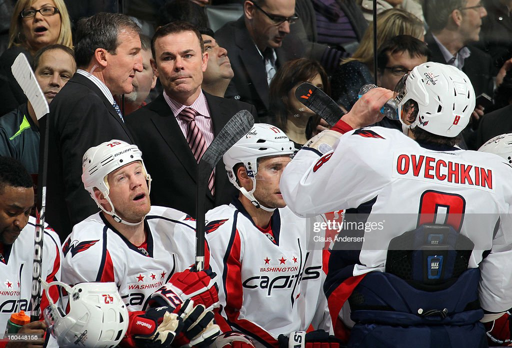 Head coach Adam Oates of the Washington Capitals listens to assisatant Tim Hunter during a game against the Toronto Maple Leafs on January 31, 2013 at the Air Canada Centre in Toronto, Canada. The Maple Leafs defeated the Capitals 3-2.