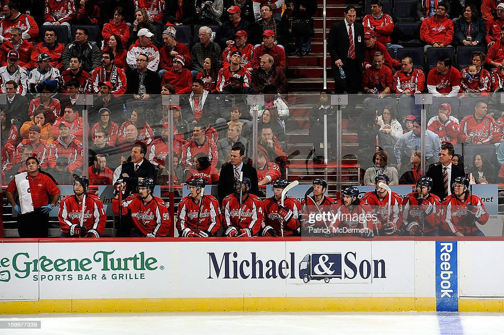 Head coach Adam Oates of the Washington Capitals look on from the bench during the third period of an NHL hockey game at Verizon Center on January 22, 2013 in Washington, DC.
