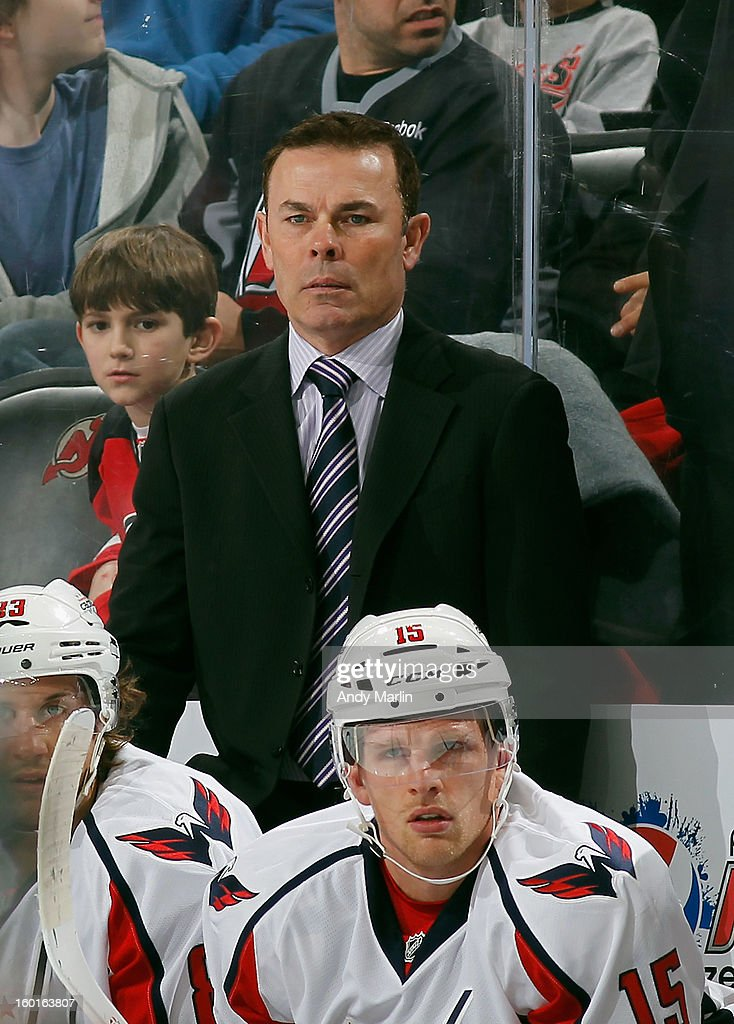 Head coach Adam Oates of the Washington Capitals looks on against the New Jersey Devils during the game at the Prudential Center on January 25, 2013 in Newark, New Jersey.