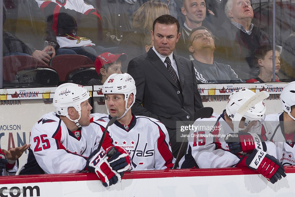 Head coach Adam Oates of the Washington Capitals looks on during an NHL game against the Ottawa Senators at Scotiabank Place on January 29, 2013 in Ottawa, Ontario, Canada.