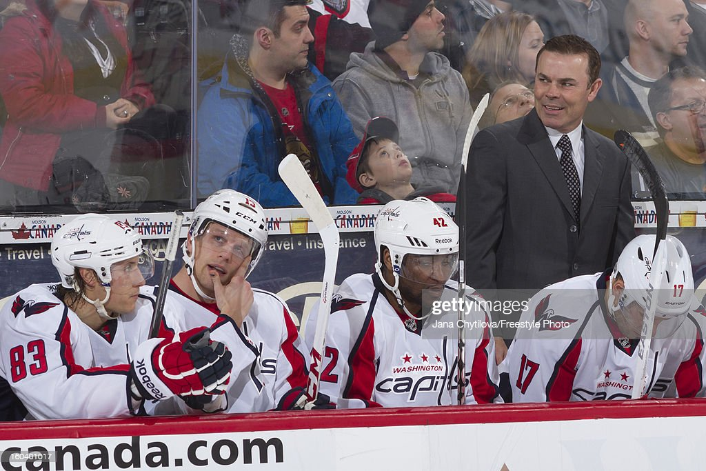 Head coach Adam Oates of the Washington Capitals looks on from the bench during an NHL game against the Ottawa Senators at Scotiabank Place on January 29, 2013 in Ottawa, Ontario, Canada.