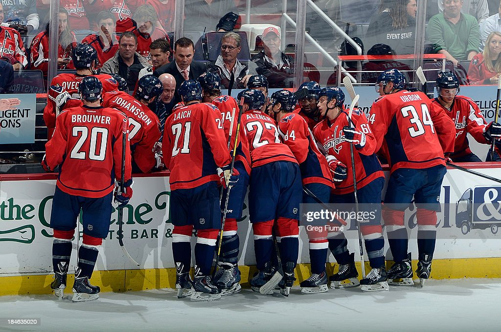 Head coach <a gi-track='captionPersonalityLinkClicked' href=/galleries/search?phrase=Adam+Oates&family=editorial&specificpeople=209315 ng-click='$event.stopPropagation()'>Adam Oates</a> of the Washington Capitals talks to his team during a time out in the third period against the Edmonton Oilers at the Verizon Center on October 14, 2013 in Washington, DC. Washington won the game 4-2.