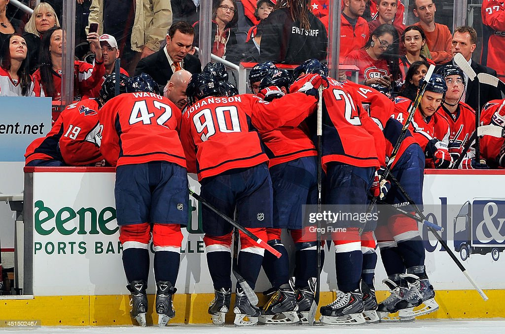 Head coach <a gi-track='captionPersonalityLinkClicked' href=/galleries/search?phrase=Adam+Oates&family=editorial&specificpeople=209315 ng-click='$event.stopPropagation()'>Adam Oates</a> of the Washington Capitals talks to his team during a timeout in the first period of the game against the Montreal Canadiens at the Verizon Center on November 22, 2013 in Washington, DC.