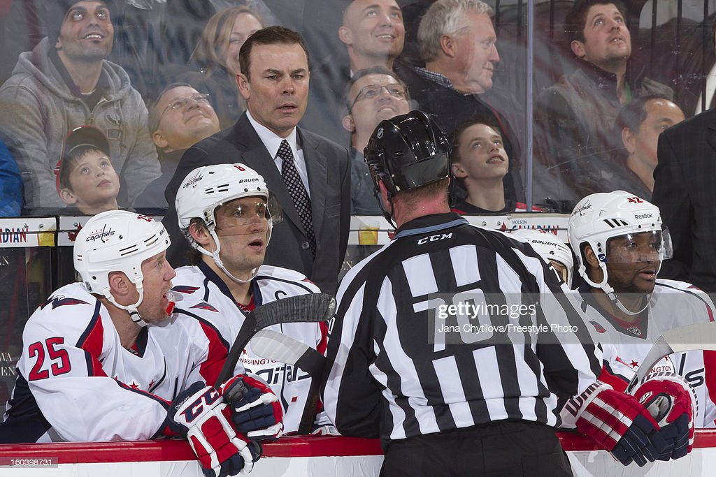 Head coach Adam Oates of the Washington Capitals talks with linesman Derek Nansen #70 during an NHL game against the Ottawa Senators at Scotiabank Place on January 29, 2013 in Ottawa, Ontario, Canada.