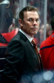 Head coach Adam Oates of the Washington Capitals watches the game during the second period against the Florida Panthers at the Verizon Center on...