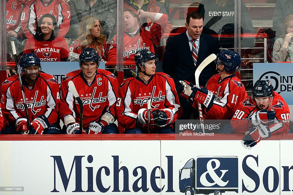 Head coach Adam Oates talks with Joey Crabb #15 of the Washington Capitals on the bench during the third period of an NHL hockey game at Verizon Center on January 22, 2013 in Washington, DC.