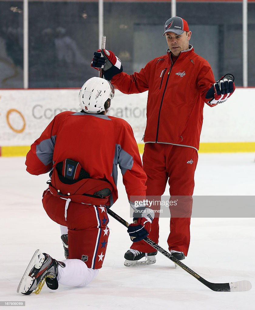Head coach Adam Oates works with Alex Ovechkin of the Washington Capitals at the Kettler Capitals Iceplex on February 23 2013 in Arlington Virginia