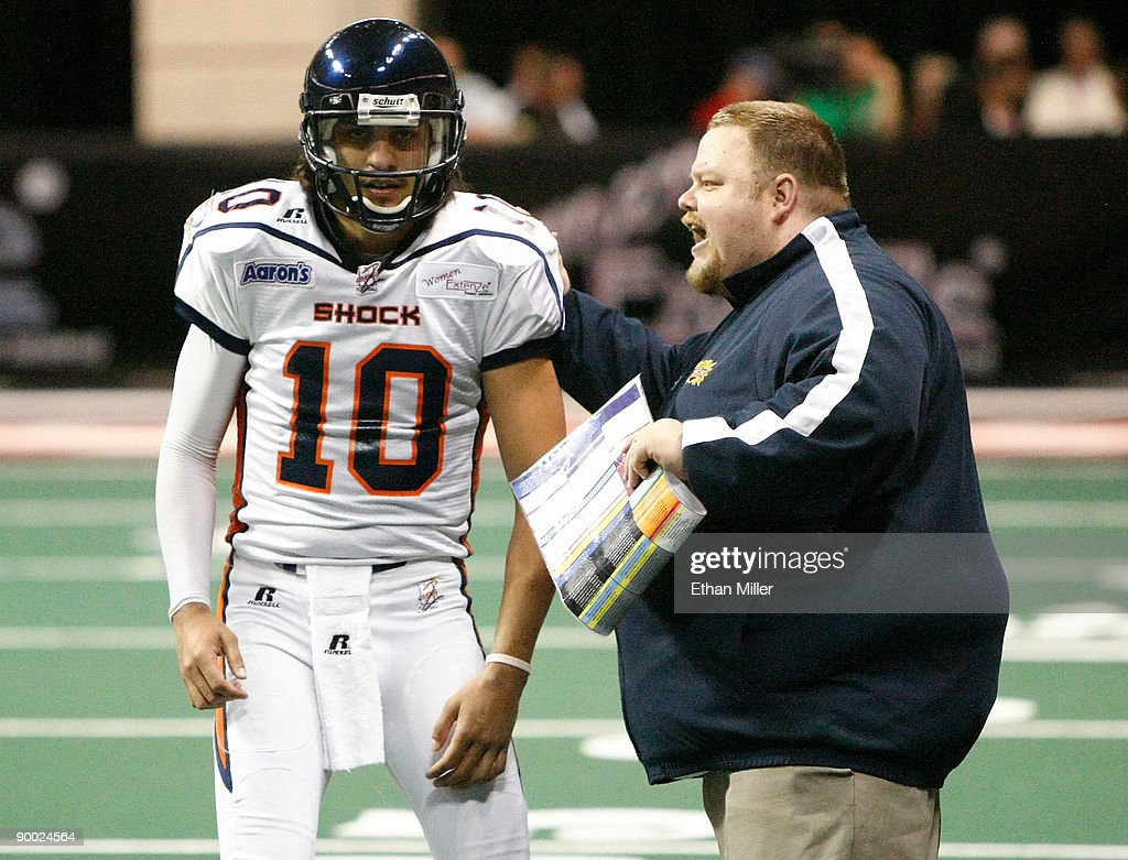 Head coach Adam Shackleford of the Spokane Shock speaks to his quarterback Nick Davila #10 during the team's 74-27 victory over the Wilkes-Barre/Scranton Pioneers in the AFL2 ArenaCup 10 at the Orleans Arena August 22, 2009 in Las Vegas, Nevada.
