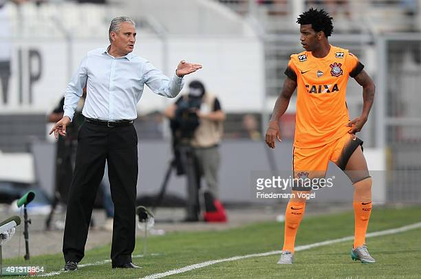 Head coach Adenor Leonardo Bachi gives advise to Gil of Corinthians during the match between Ponte Preta and Corinthians for the Brazilian Series A...
