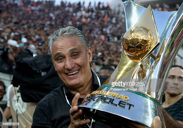 Head coach Adenor Leonardo Bachi of Corinthians celebrates with the trophy after winning the match between Corinthians and Sao Paulo for the...