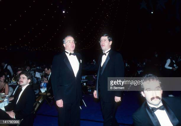 Head coach Al Arbour and general manager Bill Torrey walk to the microphone during the 1983 NHL All Star dinner on February 7 1983 in Uniondale New...