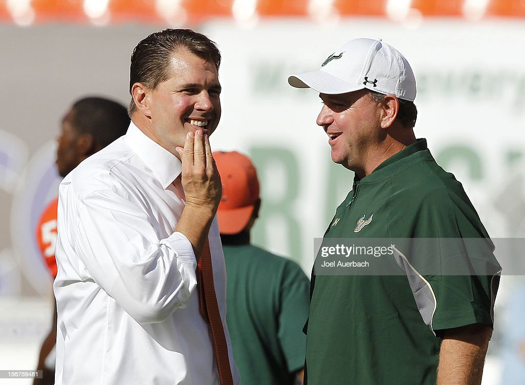 Head coach Al Golden of the Miami Hurricanes and Head coach Skip Holtz of the South Florida Bulls talk at mid field prior to the game on November 17, 2012 at Sun Life Stadium in Miami Gardens, Florida. The Hurricanes defeated the Bulls 40-9.