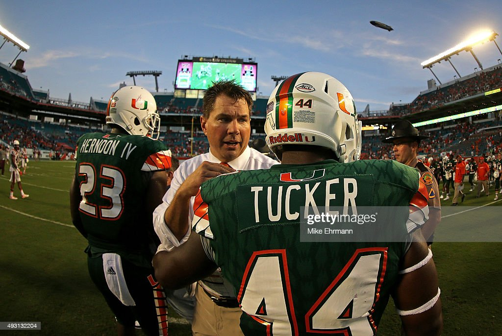 Head coach <a gi-track='captionPersonalityLinkClicked' href=/galleries/search?phrase=Al+Golden&family=editorial&specificpeople=6315572 ng-click='$event.stopPropagation()'>Al Golden</a> of the Miami Hurricanes congratulates Walter Tucker #44 during a game against the Virginia Tech Hokies at Sun Life Stadium on October 17, 2015 in Miami Gardens, Florida.