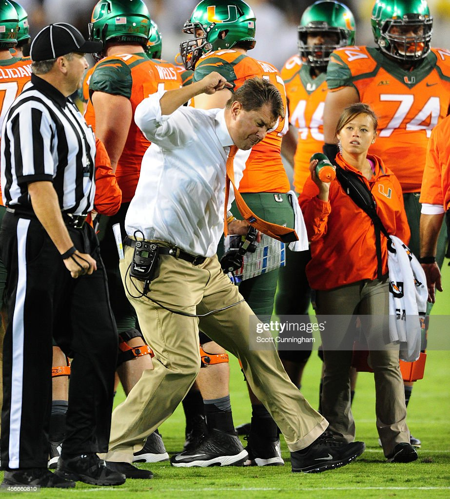 Head Coach <a gi-track='captionPersonalityLinkClicked' href=/galleries/search?phrase=Al+Golden&family=editorial&specificpeople=6315572 ng-click='$event.stopPropagation()'>Al Golden</a> of the Miami Hurricanes disputes a call with an official during the game against the Georgia Tech Yellow Jackets at Bobby Dodd Stadium on October 4, 2014 in Atlanta, Georgia.