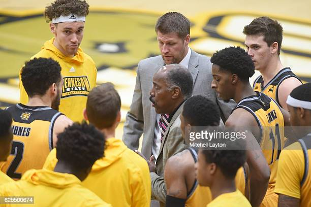 Head coach Al Skinner of the Kennesaw State Owls talks to his players during a college basketball game against the UMBC Retrievers at the RAC Arena...