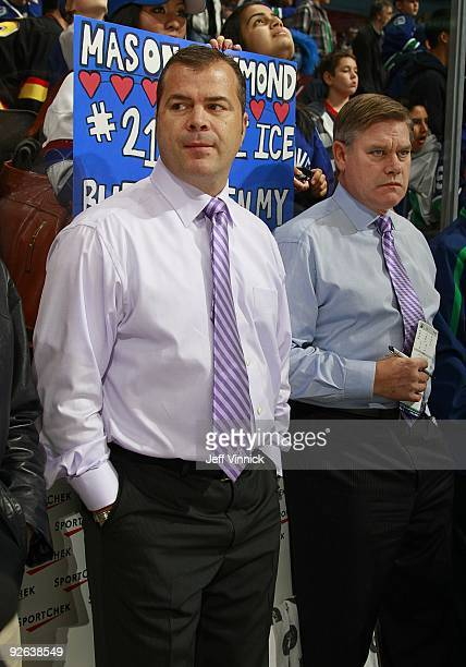 Head coach Alain Vigneault and assistant coach Ryan Walter of the Vancouver Canucks look on from the bench during their game against the Edmonton...