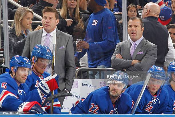 Head coach Alain Vigneault and assistant coach Ulf Samuelsson of the New York Rangers sport purple ties in honor of Hockey Fights Cancer Awareness...