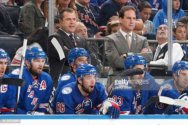 Head coach Alain Vigneault and associate coach Scott Arniel of the New York Rangers follow the action from the bench during the game against the San...