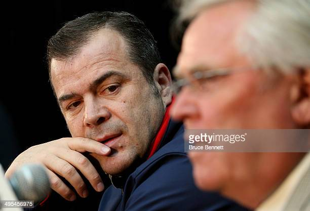 Head Coach Alain Vigneault and Glen Sather President and General Manager of the New York Rangers speak during Media Day for the 2014 NHL Stanley Cup...