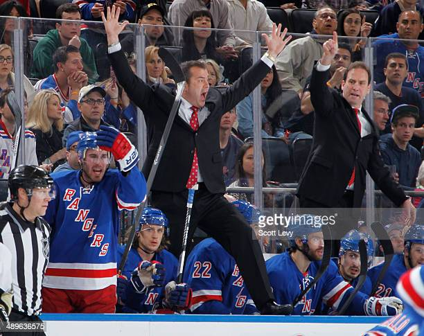 Head Coach Alain Vigneault of the New York Rangers calls for a penalty from the bench against the Pittsburgh Penguins in Game Six of the Second Round...
