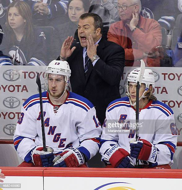Head coach Alain Vigneault of the New York Rangers calls from the bench in thirdperiod action in an NHL game against the Winnipeg Jets at the MTS...