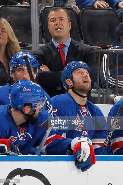 Head coach Alain Vigneault of the New York Rangers looks on from the bench during the game against the Winnipeg Jets at Madison Square Garden on...