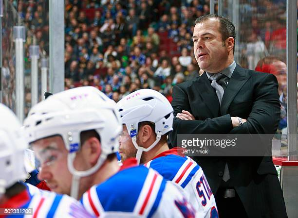 Head coach Alain Vigneault of the New York Rangers looks on from the bench from the bench during their NHL game against the Vancouver Canucks at...