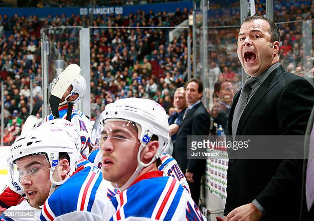 Head coach Alain Vigneault of the New York Rangers shouts instructions from the bench against the Vancouver Canucks during their NHL game at Rogers...