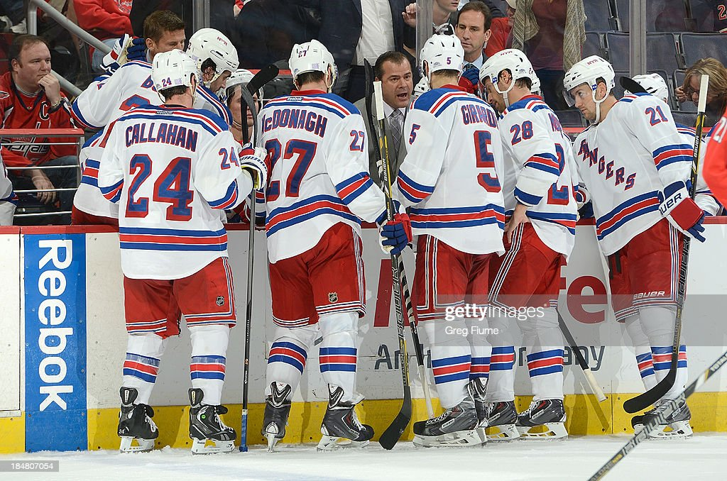 Head coach <a gi-track='captionPersonalityLinkClicked' href=/galleries/search?phrase=Alain+Vigneault&family=editorial&specificpeople=4146583 ng-click='$event.stopPropagation()'>Alain Vigneault</a> of the New York Rangers talks to his team during a time out in the third period against the Washington Capitals at the Verizon Center on October 16, 2013 in Washington, DC. New York won the game 2-0.