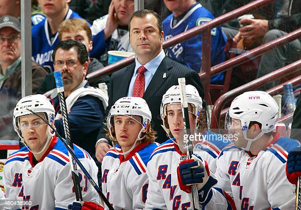 Head coach Alain Vigneault of the New York Rangers watches as his team skates to victory over the Vancouver Canucks in their NHL game at Rogers Arena...