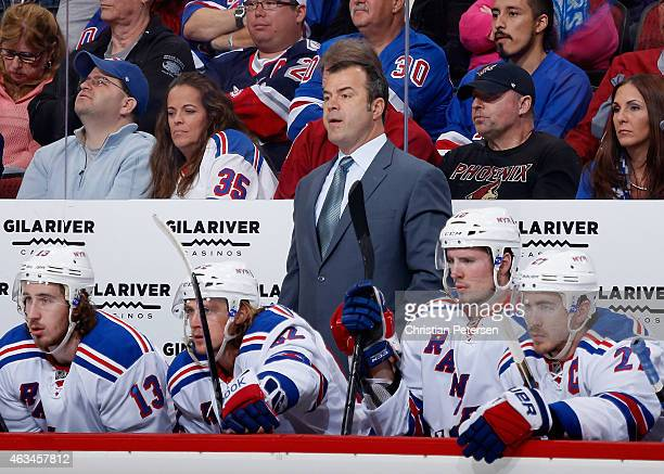 Head coach Alain Vigneault of the New York Rangers watches from the bench during the first period of the NHL game against the Arizona Coyotes at Gila...