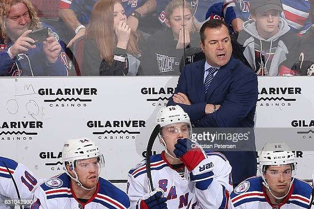 Head coach Alain Vigneault of the New York Rangers watches from the bench during the third period of the NHL game against the Arizona Coyotes at Gila...