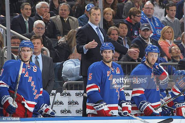 Head coach Alain Vigneault of the New York Rangers watches the action from the bench against the Pittsburgh Penguins in Game Five of the Eastern...