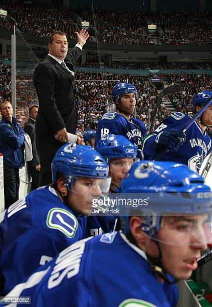 Head coach Alain Vigneault of the Vancouver Canucks looks on from the bench during their game against the Detroit Red Wings at General Motors Place...