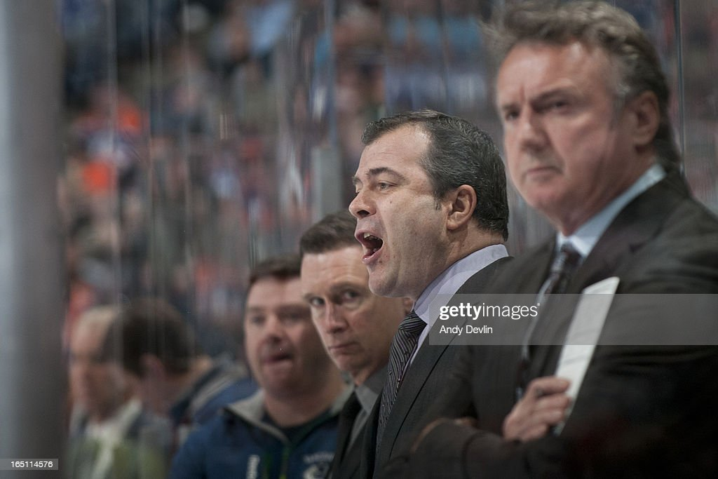 Head Coach Alain Vigneault of the Vancouver Canucks tries to encourage his team after spotting the Edmonton Oilers a three goal lead in the first period on March 30, 2013 at Rexall Place in Edmonton, Alberta, Canada.
